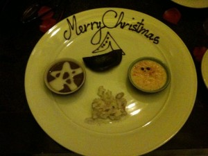 A crappy iPhone picture of the dessert platter, chocolate mousse, chocolate dumpling, crème brûlée and a sticky rice thing